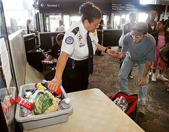 TSA lady taking toiletries at OAK - Nick Lammers - STAFF